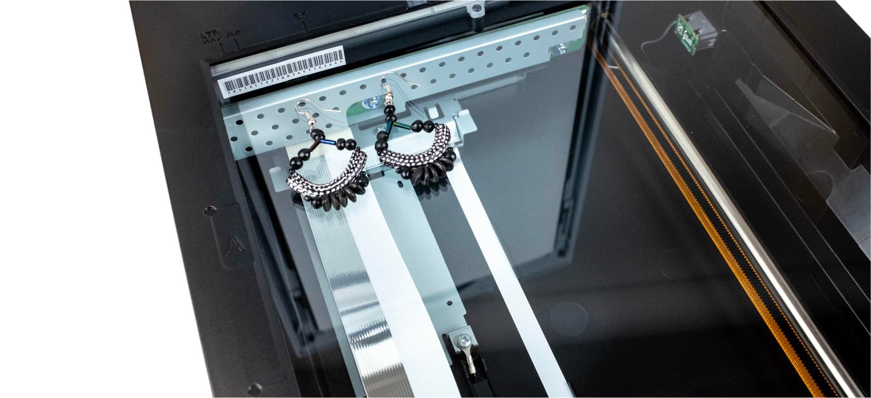 Earrings placed on scanner bed