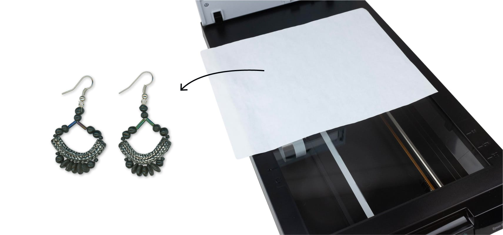 Paper placed on earrings on scanner bed and final image result
